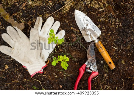soil, to care for plants, gardening tools work on the farm, gloves,  - stock photo