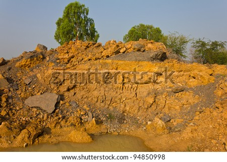 Soil under the road. Condition of the road to water erosion as the cliff. - stock photo