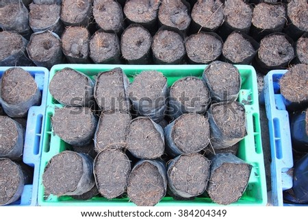 soil with dry grass in bags for agriculture - stock photo