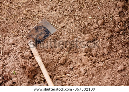 Soil with Hoe gardening tool