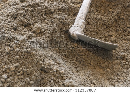 soil with hoe or digging tool - stock photo
