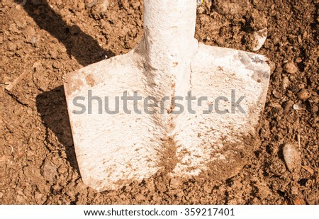 Soil with shovel. Close-up, shallow  - stock photo