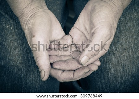 Soiled hands of elderly women