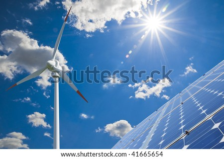 Solar and wind energy for clean environment - stock photo