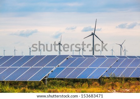 solar and wind power in coastal mud flat, renewable energy background.
