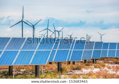 solar and wind power in coastal saline and alkaline land, develop shoals background. - stock photo