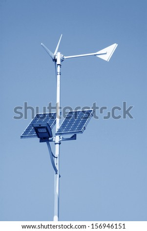 solar and wind power street lights in the sky - stock photo