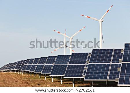 solar array and wind turbines - stock photo