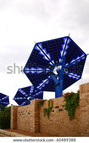 Solar battery and brick fence - stock photo