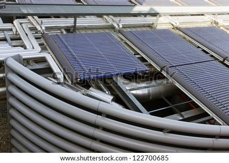 solar battery,ventilation of air conditioner compressor - stock photo
