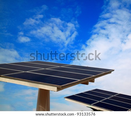 Solar cell and blue sky - stock photo