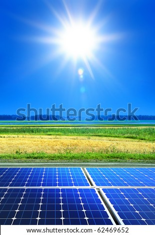 solar cell array in the field, renewable energy - stock photo