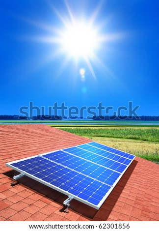 solar-cell array on the roof of private home - stock photo