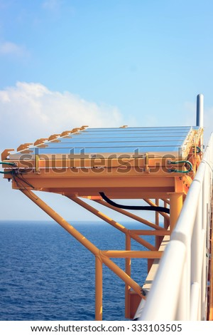 solar cell at offshore platform and sea beautiful blue sky.