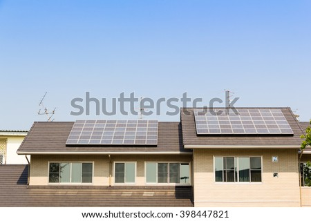 solar cell on top of house roof against blue sky  concept : clean energy, selective energy - stock photo
