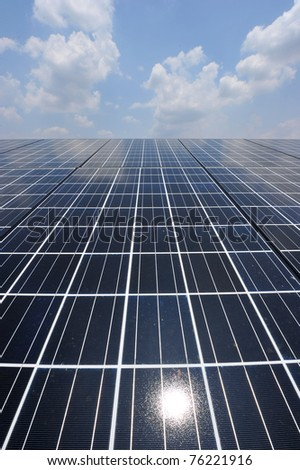 Solar cell over the blue sky and reflect the sun. - stock photo