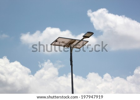 Solar Cell Panel and lanterns street on blue sky background.
