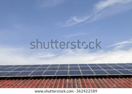 solar cell panel on red roof and cloud blue sky , Energy saving concept - stock photo