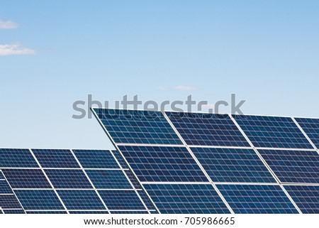 Solar cell panels against blue sky background. Alternative energy system and ecological problems concept, copy space