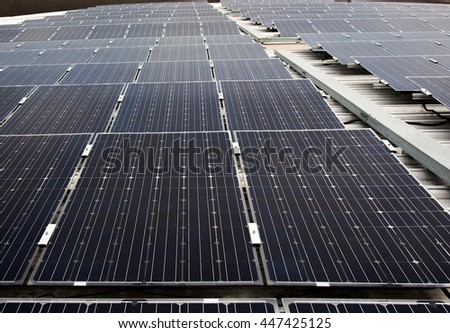Solar cell panels in a photovoltaic power plant, Solar cell using renewable solar energy. - stock photo