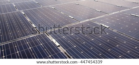 Solar cell panels in a photovoltaic power plant, Solar cell using renewable solar energy, Light source from top right sunset - stock photo