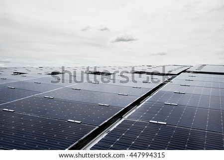 Solar cell panels in a photovoltaic power plant, Solar cell using renewable solar energy with solar panels on the metal sheet roof - stock photo