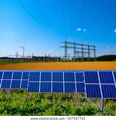 Solar cell power station, electric substation and power lines - stock photo