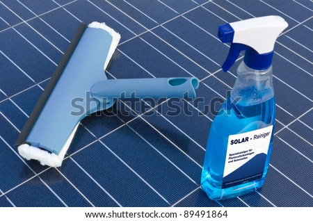 Solar cells and detergent  - german - stock photo