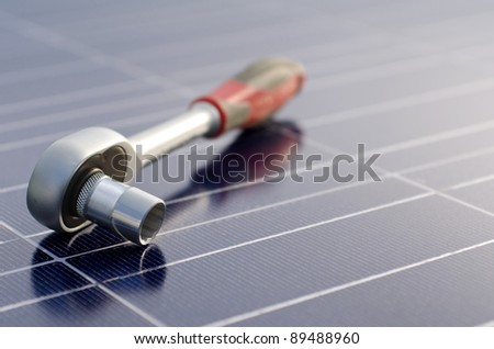 Solar cells and ratchet wrench - stock photo
