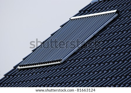 Solar cells on a new blue roof - stock photo