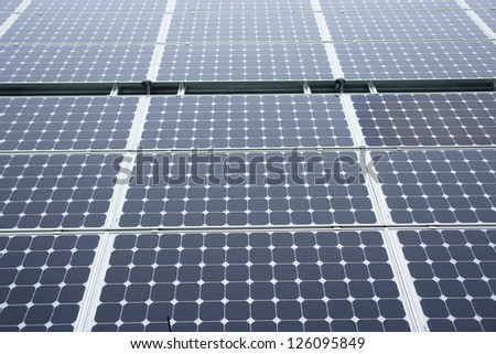 Solar-cells on a roof outside on a day - stock photo