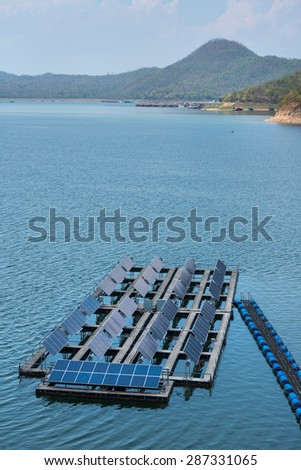 Solar cells on the lake of Srinagarindra Dam on  Khwae Yai River Thailand  - stock photo