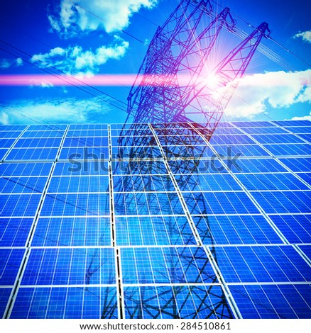 Solar cells, power pole and red laser ray - stock photo