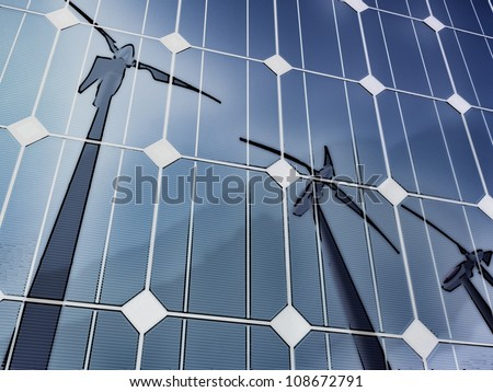 Solar cells reflecting the sky and some wind turbines, illustrating concepts such as green power, greentech, environmental protection, sustainable growth and technologies in general - stock photo