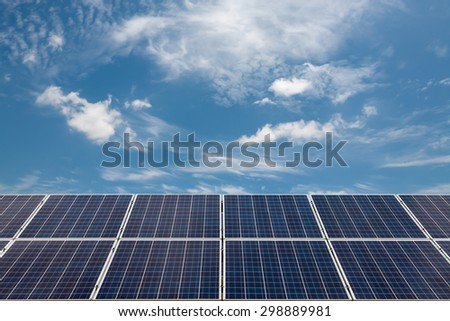 solar cells with blue sky and cloud - stock photo