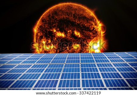 Solar cells with sun in outer space - Elements of this image furnished by NASA - stock photo