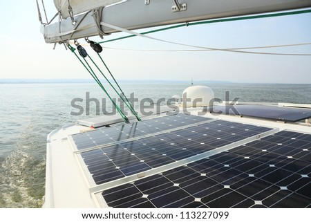 Solar charging batteries aboard a sail boat Photovoltaic panels energy concept - stock photo