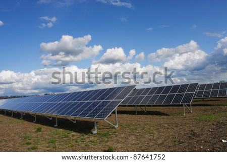 solar collector energy plant outside against sky - stock photo