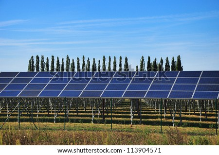 Solar collector on field, photovoltaic panel. - stock photo