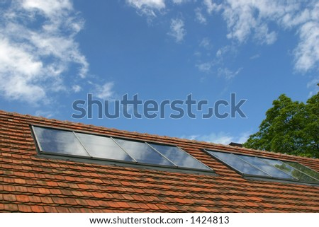Solar collectors for water heating on the tiled roof