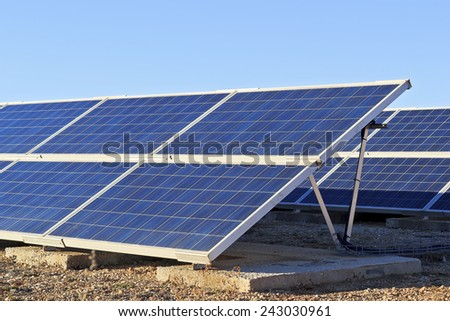 Solar collectors, transforming solar energy into electricity - stock photo
