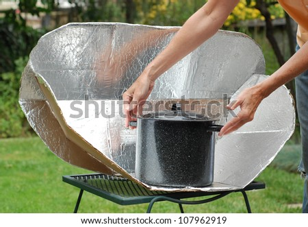 Solar Cooking Oven with black pot. - stock photo