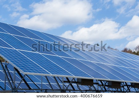 Solar enegy station under blue sky
