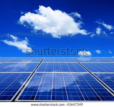 Solar energy panel with blue sky and clouds - stock photo