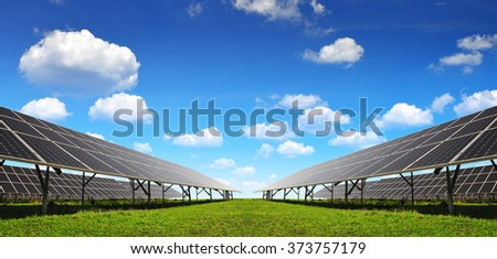 Solar energy panels against blue sky with clouds. - stock photo