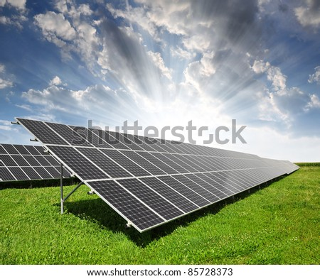 Solar energy panels against sky - stock photo