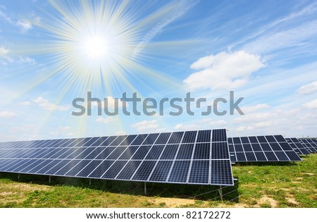 Solar energy panels against sunny sky. - stock photo