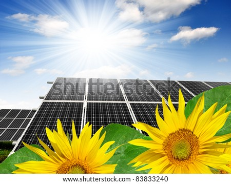 Solar energy panels against sunny sky - stock photo