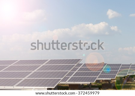 Solar energy panels against sunny sky.Clean energy.Nature conservation - stock photo