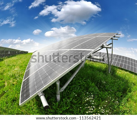 Solar energy panels against sunny sky - fisheye shot - stock photo